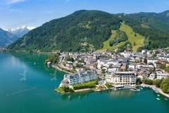 Luftaufnahme- Grand Hotel Zell am See im Fokus, Hintergrund Kitz
